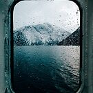 Norwegian Fjord During Winter Photographed Through Wet Ferry Window by visualspectrum