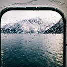 Norwegian Fjord During Winter Shot Through Wet Ferry Window by visualspectrum