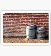 Wine barrels next to red brick wall at the Jennie Wade House in Gettysburg, Pennsylvania Sticker