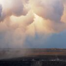 low-lying clouds drift across Halemaumau Crater by Lawrence Taguma