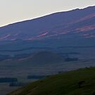 breaking light on slopes of Mauna Kea by Lawrence Taguma
