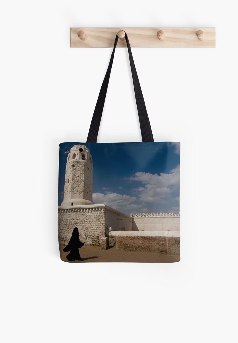 78380a6eb5b4 Yemeni woman passing a mosque - Yemen