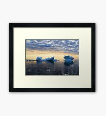 Ice in sea water against the sunset sky Framed Print
