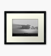 Evening clouds over the sea Framed Print