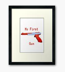 My First Gun Framed Print