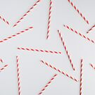 Colorful pink paper straws on white background by Adam Nixon