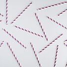 Colorful purple paper straws on white background by Adam Nixon