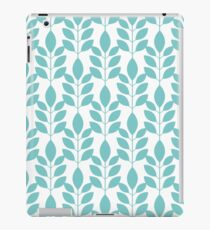 Symmetrical seamless floral pattern with blue leaves on a white background. Delicate flora. Vector illustration. iPad Case/Skin