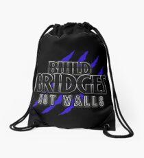 BUILD BRIDGES NOT WALLS 2.0 Drawstring Bag