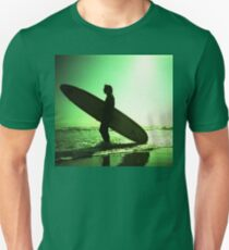 Surfer carrying surfboard in surreal silhouette in green in sea ocean water by beach 35mm analog xpro cross lomo lca photo T-Shirt