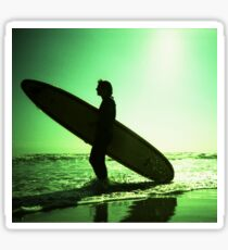Surfer carrying surfboard in surreal silhouette in green in sea ocean water by beach 35mm analog xpro cross lomo lca photo Sticker