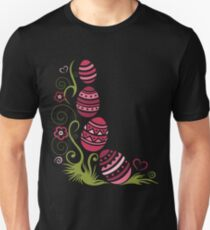Easter eggs in the grass with flowers. Unisex T-Shirt