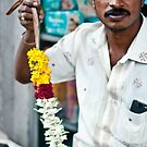 Candid portrait of a flower seller by UniSoul