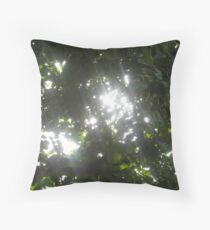 Sunlight streaming through the fronds of a lush thick tree Throw Pillow