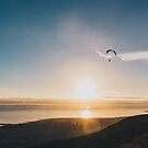 Sunset Paragliding over beach and mountains by lightwanderer