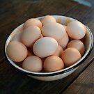 Fresh eggs on an old farm table by Hickoryhill