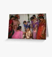 Womenfolk applying kumkum and haldi Greeting Card
