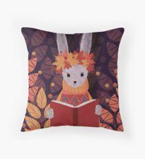 reading rabbit Throw Pillow
