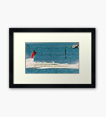 A Wake-boarder in the middle of a manoeuvre Framed Print