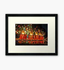 Monks releasing paper Chinese lantern at loy krathong festival of light  Framed Print
