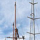 Man between masts. by Alex Preiss