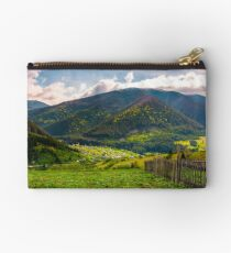 village in valley on a cloudy springtime day Studio Pouch