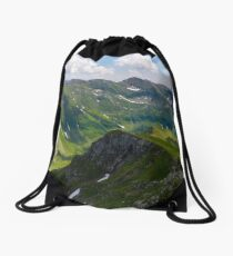 valley with snow in summer mountains Drawstring Bag