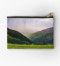 mountains on a cloudy springtime day Studio Pouch