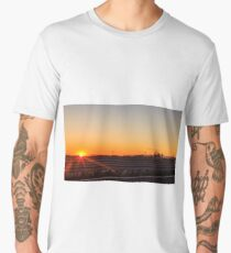 sun goes down behind an industry Men's Premium T-Shirt