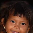 Child by the boat ramp as we left Lake Tonlie Sap, Cambodia by Bev Pascoe