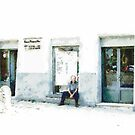 Old man sitting In front of a shop by Giuseppe Cocco