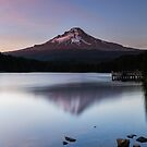 People standing on a dock watching the sunset on Mount Hood and Trillium Lake by Adam Nixon