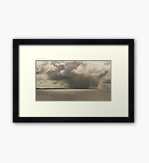 Snow Cloud Over Water Framed Print