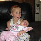 Lucas holding his baby cousin..... by agfoster76