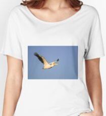 White Pelican, Pelecanus onocrotalus in flight with a blue sky background. Women's Relaxed Fit T-Shirt