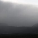 rain over Byron Ledge, Kilauea Caldera by Lawrence Taguma