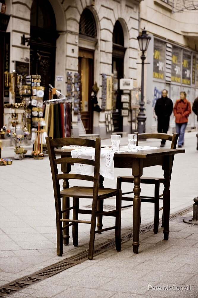 a table set in the street by pmacimagery
