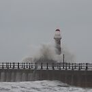 Roker pier lighthouse during the stormy weather by Tony Blakie