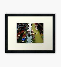 floating market Framed Print