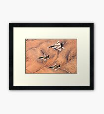 A formation of 2 F-16 and one F-15 Israeli Air Force fighter jets flying over the Judea mountains Dead sea area, Israel  Framed Print