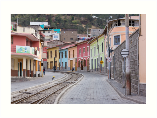 Railroad tracks winding through Alausi colourful streets, Ecuador by Kendall Anderson