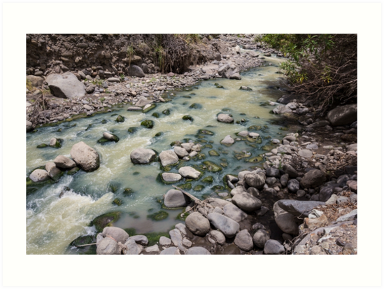 Green rushing water over rocks at base of valley, Sibambe, Ecuador by Kendall Anderson