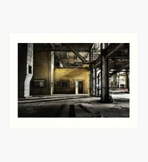Yellow brick wall outside control room in abandoned industrial coal power station with open door and steel columns Art Print