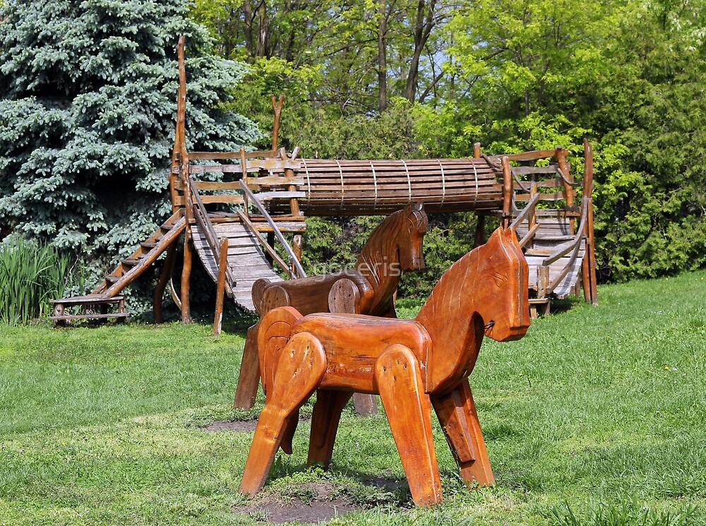 playground with wooden horses by goceris