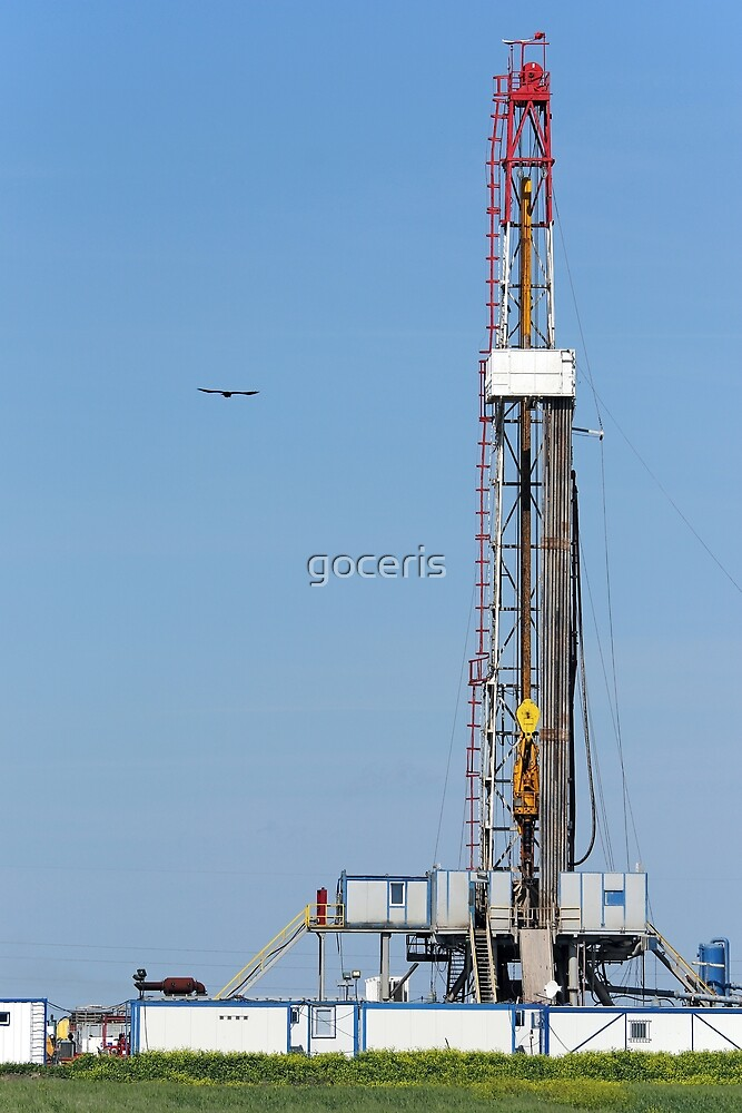 oil drilling rig on green field by goceris