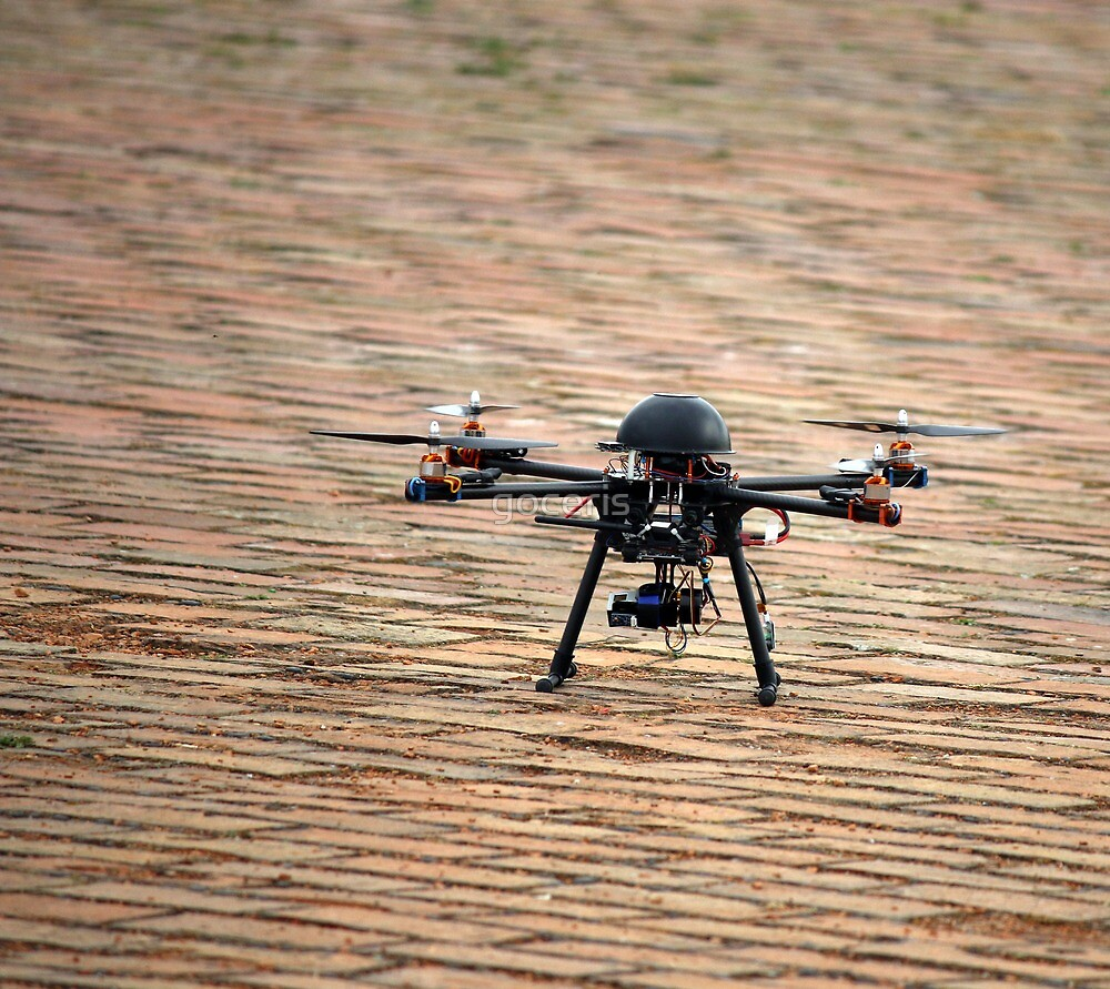 flying drone with camera on ground by goceris