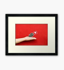 send heart to you on a hand Framed Print
