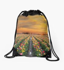 Sunset over colorful Tulip flower fields in full bloom spring season in Woodburn Oregon Drawstring Bag