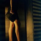 Sensual young lady in heels at night analog darkroom print by edwardolive
