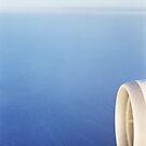 Plane wing in blue sky analogue 35mm film ra-4 darkroom prints by edwardolive